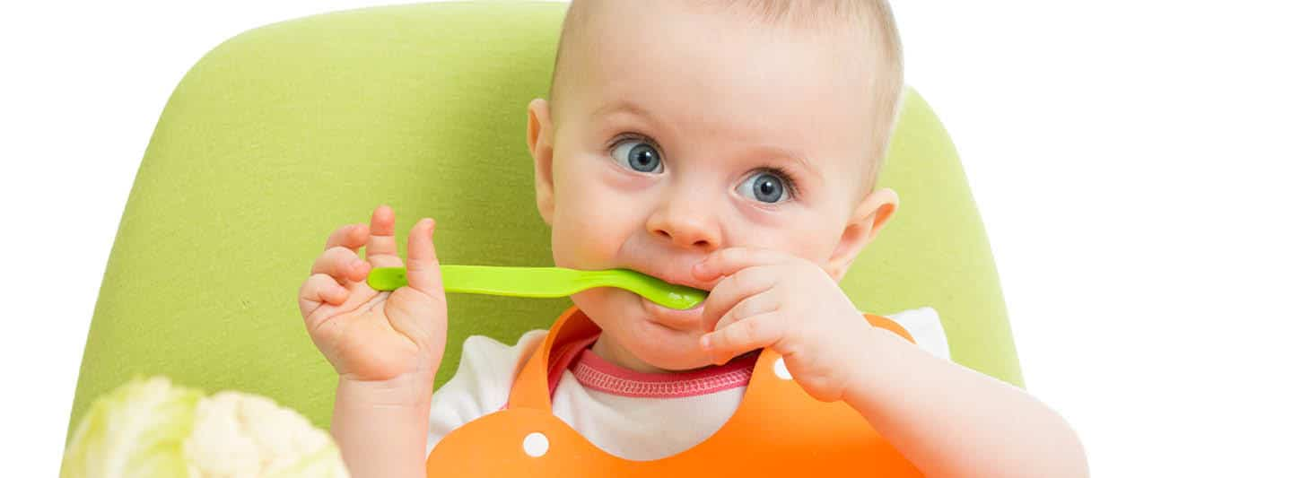 How to Teach Your Baby to Use a Spoon | New Ways Nutrition