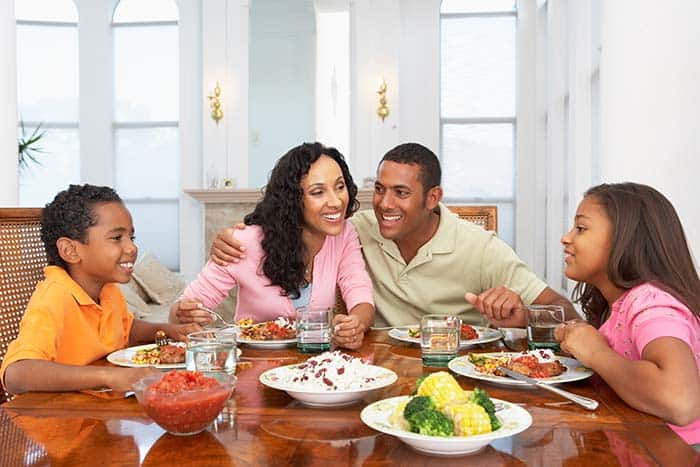 Family eating at table together